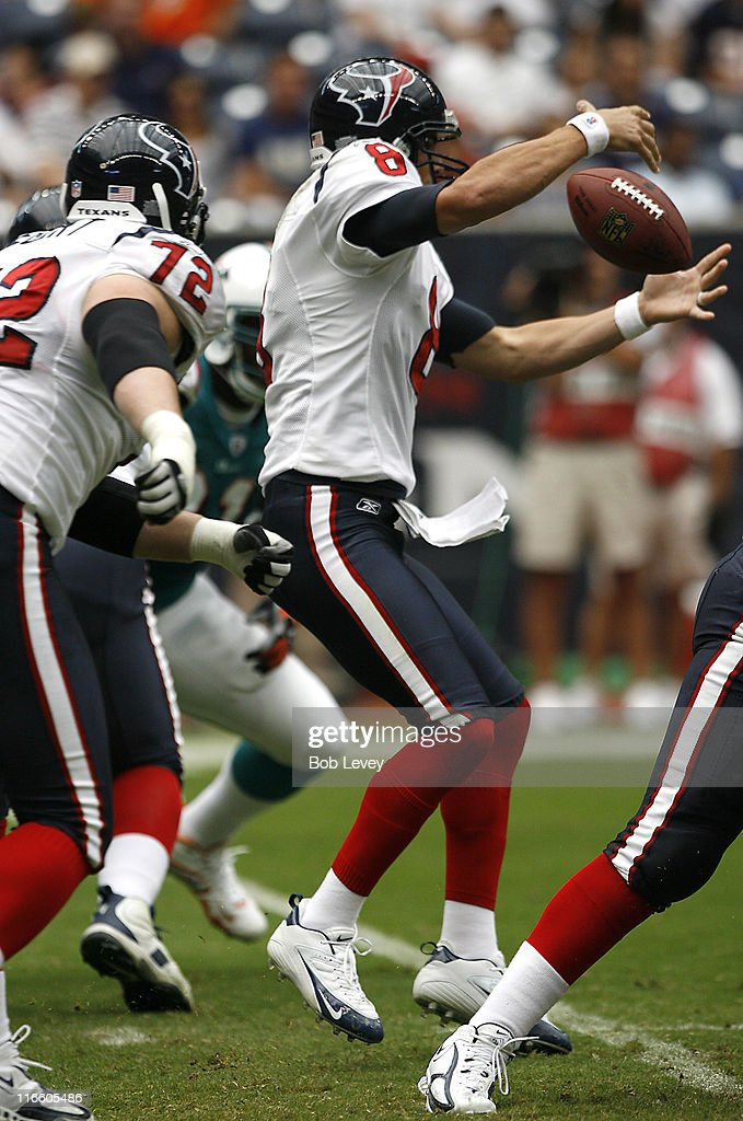 Houston Texans quarterback David Carr has the ball come loose after it was deflected out of this hand The Houston Texans defeated the Miami Dolphins...