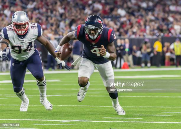 Houston Texans quarterback Deshaun Watson carries the ball toward the end zone and scores a touchdown during the NFL preseason game between the New...