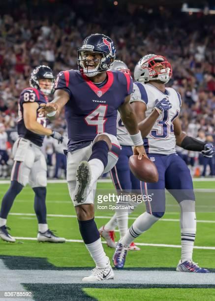 Houston Texans quarterback Deshaun Watson celebrates after scoring a touchdown in the third quarter of the NFL preseason game between the New England...