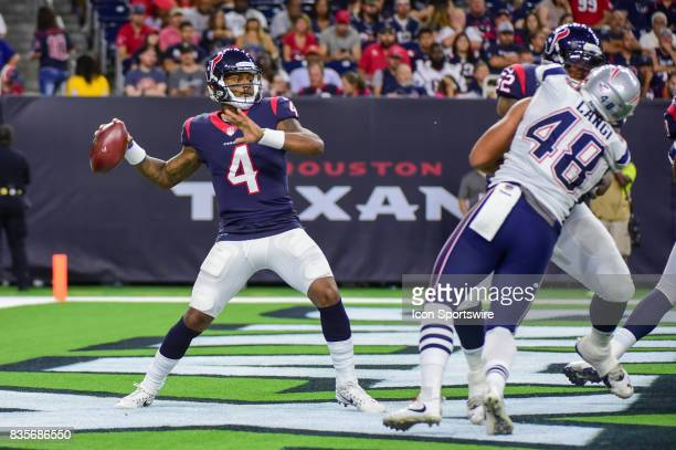 Houston Texans quarterback Deshaun Watson looks to pass from his own endzone during the NFL preseason game between the New England Patriots and the...