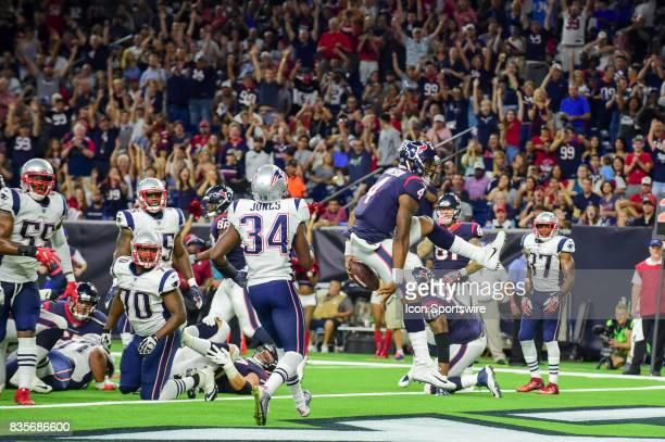 Houston Texans quarterback Deshaun Watson scores a rushing touchdown during the NFL preseason game between the New England Patriots and the Houston...