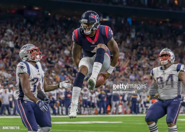 Houston Texans quarterback Deshaun Watson scores a touchdown in the third quarter of the NFL preseason game between the New England Patriots and...