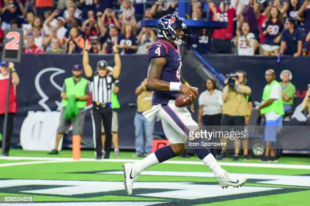 Houston Texans quarterback Deshaun Watson screams as the official signals touchdown during the NFL preseason game between the New England Patriots...