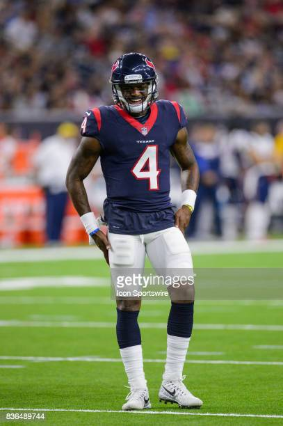 Houston Texans quarterback Deshaun Watson smiles at the sideline during the NFL preseason game between the New England Patriots and the Houston...