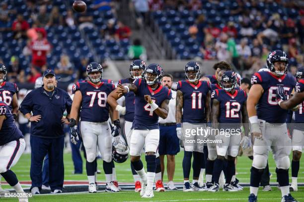 Houston Texans quarterback Deshaun Watson warms up before the NFL preseason game between the New England Patriots and the Houston Texans on August...