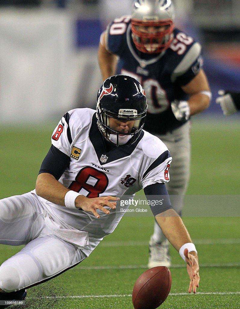 Houston Texans quarterback Matt Schaub (#8) recovers his own fumble during the third quarter as the New England Patriots hosted the Houston Texans in an NFL AFC Divisional Playoff Game at Gillette Stadium, Jan. 13, 2013.