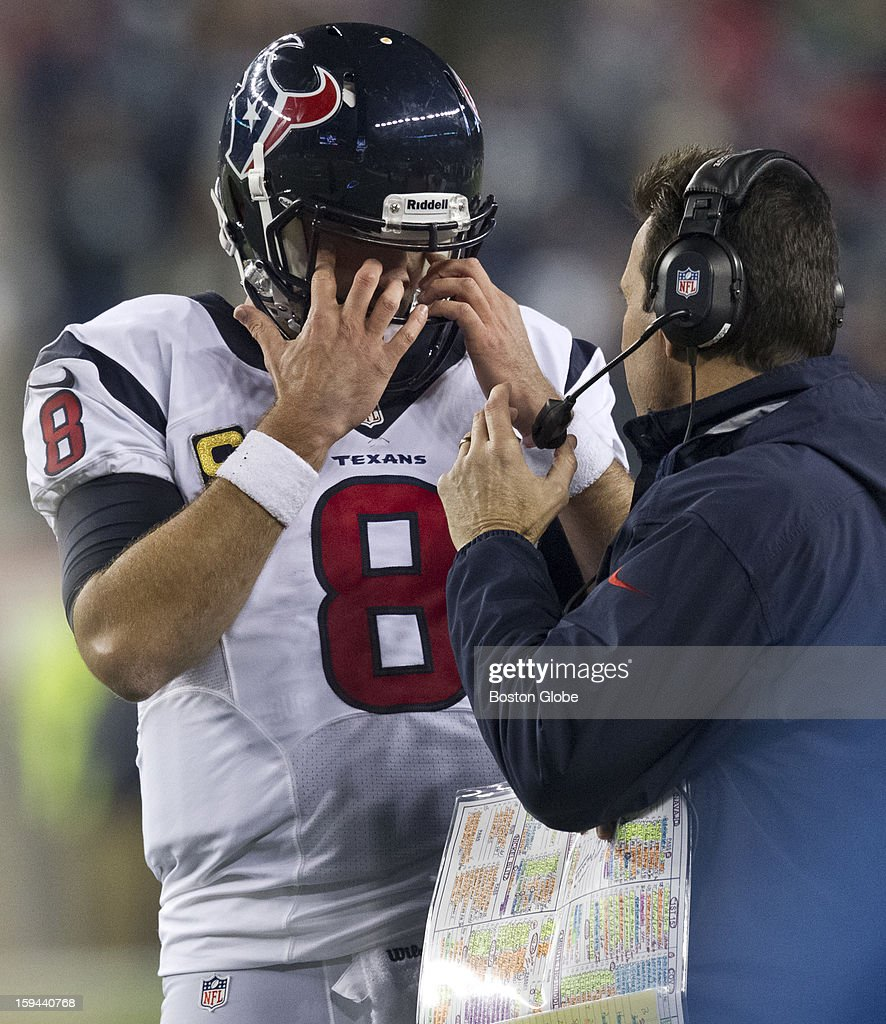 Houston Texans quarterback Matt Schaub talks to head coach Gary Kubiak during an official timeout against the New England Patriots during fourth quarter action as the New England Patriots hosted the Houston Texans in an NFL AFC Divisional Playoff Game at Gillette Stadium, Jan. 13, 2013.