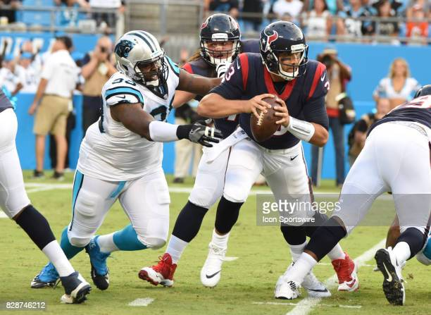 Houston Texans quarterback Tom Savage is under pressure in the preseason game between the Houston Texans and the Carolina Panthers on August 9 2017...