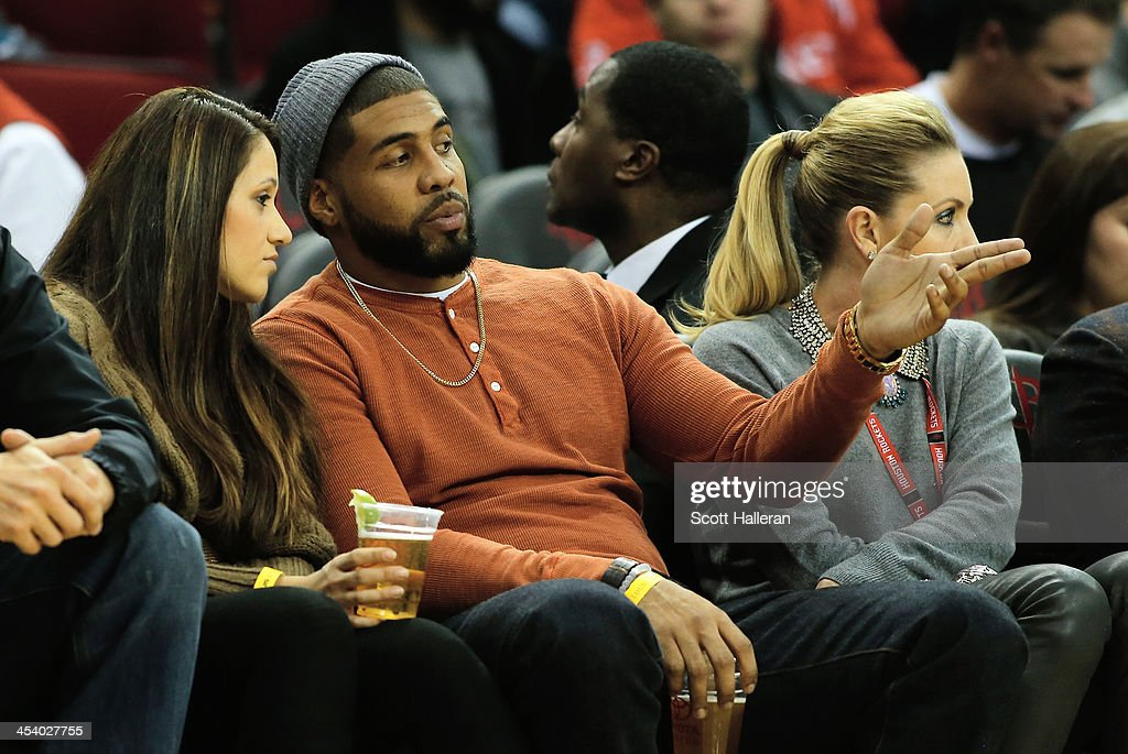 Houston Texans running back <a gi-track='captionPersonalityLinkClicked' href=/galleries/search?phrase=Arian+Foster&family=editorial&specificpeople=2128663 ng-click='$event.stopPropagation()'>Arian Foster</a> sits with his wife Romina during the game against the Golden State Warriors at Toyota Center on December 6, 2013 in Houston, Texas.