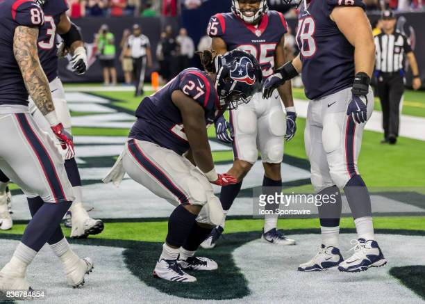 Houston Texans running back D'Onta Foreman celebrates after scoring a touchdown in the fourth quarter of the NFL preseason game between the New...