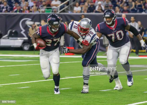 Houston Texans running back D'Onta Foreman pushes away New England Patriots defensive lineman Adam Butler during the NFL preseason game between the...