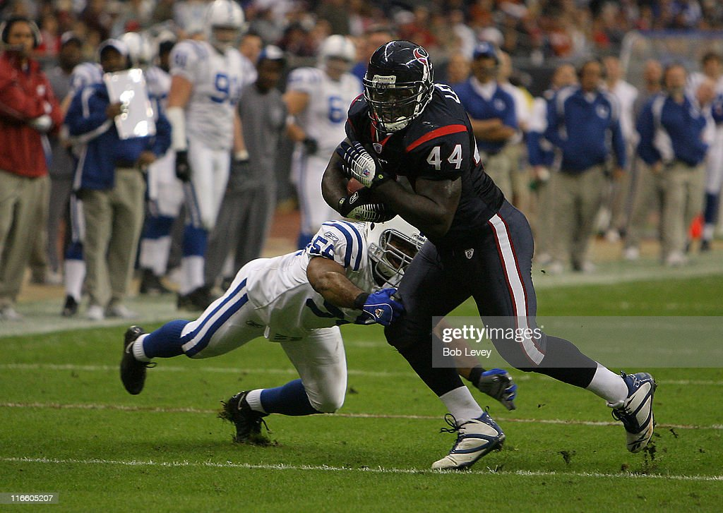 Houston Texans running back Vonta Leach races past Indianapolis Colts linebacker Cato June The Texans defeated the Colts 2724 Dec 24 2006 in Houston...