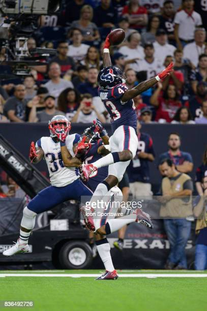 Houston Texans strong safety Corey Moore breaks up a pass during the NFL preseason game between the New England Patriots and the Houston Texans on...