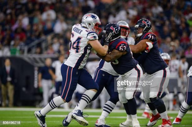 Houston Texans tackle Kendall Lamm blocks New England Patriots defensive end Caleb Kidder during the NFL preseason game between the New England...