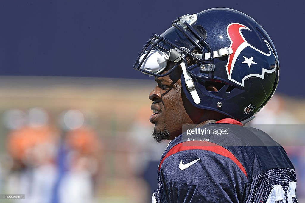 Houston Texans wide receiver <a gi-track='captionPersonalityLinkClicked' href=/galleries/search?phrase=Andre+Johnson+-+American+Football+Wide+Receiver&family=editorial&specificpeople=12734870 ng-click='$event.stopPropagation()'>Andre Johnson</a> (80) looks on during practice August 20, 2014 at Dove Valley.