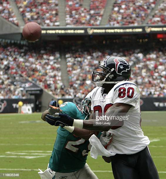 Houston Texans wide receiver Andre Johnson makes a reception over Miami Dolphins cornerback Derrick Johnson in the endzone for a touchdown in the...