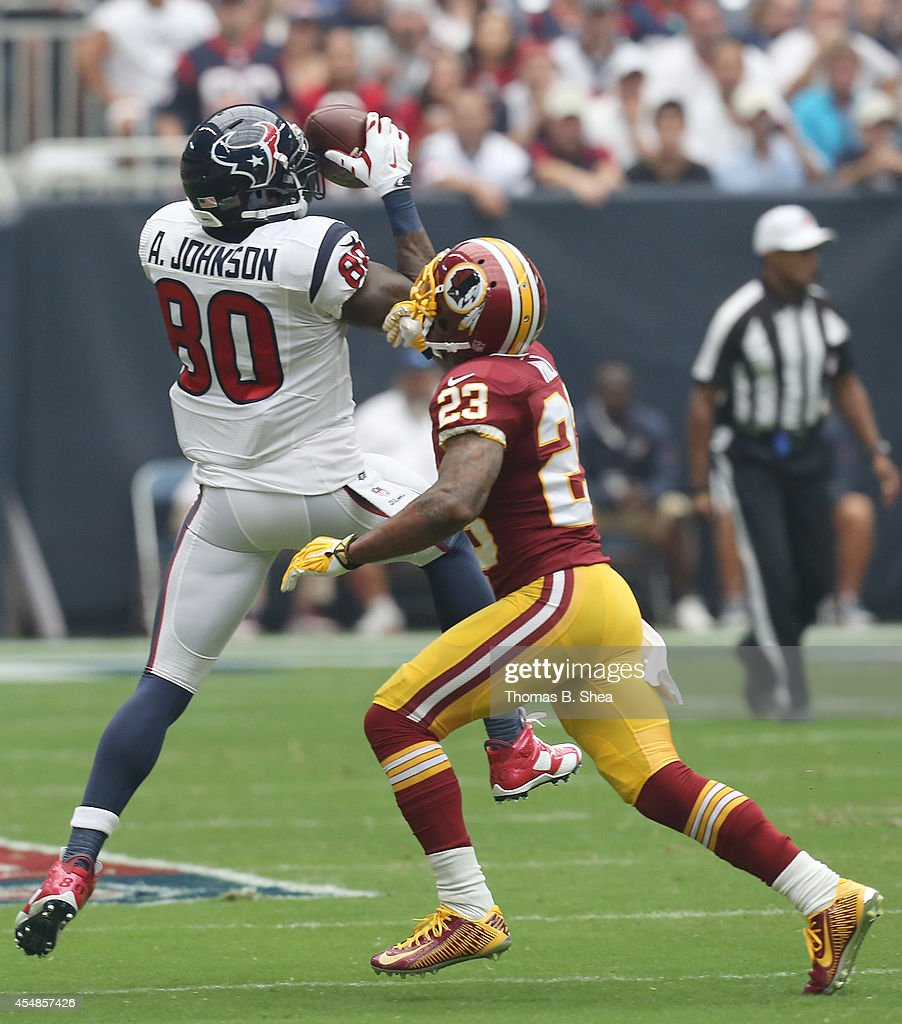 Houston Texans wide receiver Andre Johnson makes the catch against Washington Redskins cornerback DeAngelo Hall in the first quarter on September 7...