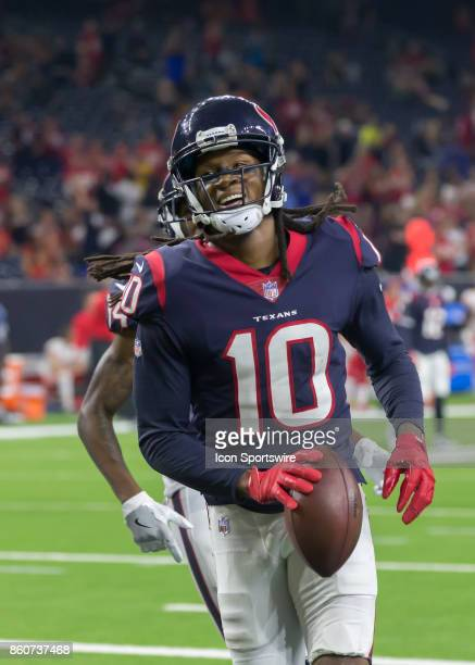Houston Texans wide receiver DeAndre Hopkins looks for his family after scoring a touchdown in the fourth quarter of the football game between the...
