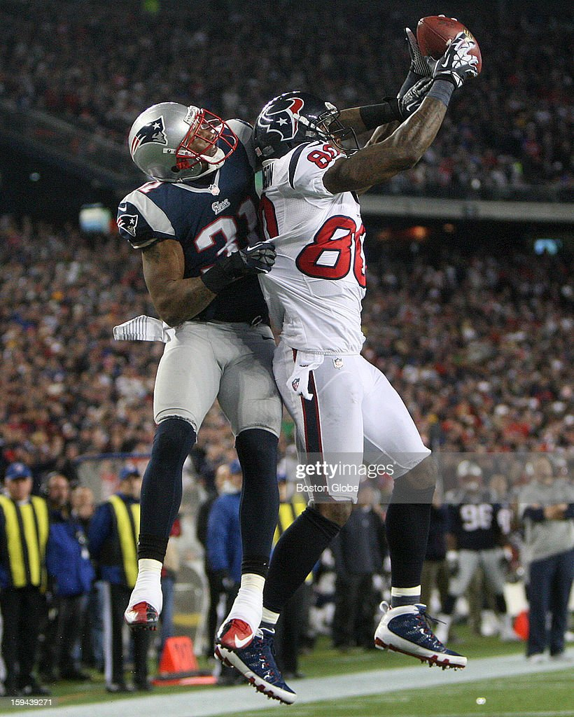 Houston Texans wide receiver Johnson, Andre (#80) pulls in a pass for the two-point conversion on a Texans touchdown in the fourth quarter as New England Patriots cornerback Aqib Talib (#31) defends on the play as the New England Patriots hosted the Houston Texans in an NFL AFC Divisional Playoff Game at Gillette Stadium, Jan. 13, 2013.