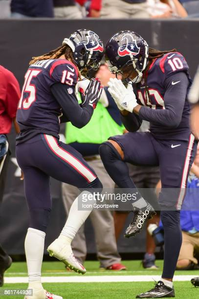 Houston Texans wide receiver Will Fuller V and Houston Texans wide receiver DeAndre Hopkins celebrate Hopkins' second half touchdown reception during...