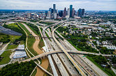 Houston Texas Aerial Over Passing Interchanges Cityscape the large mega city of H-Town is shown here during middle of summer August 14th 2016 . High above the city with over passing , intersection roa