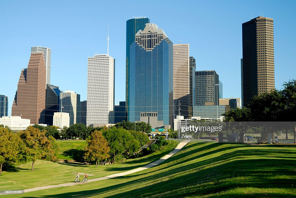 Houston, Texas Skyline Across Park with Cyclists