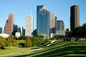 Houston, Texas Skyline Across Park with Cyclists