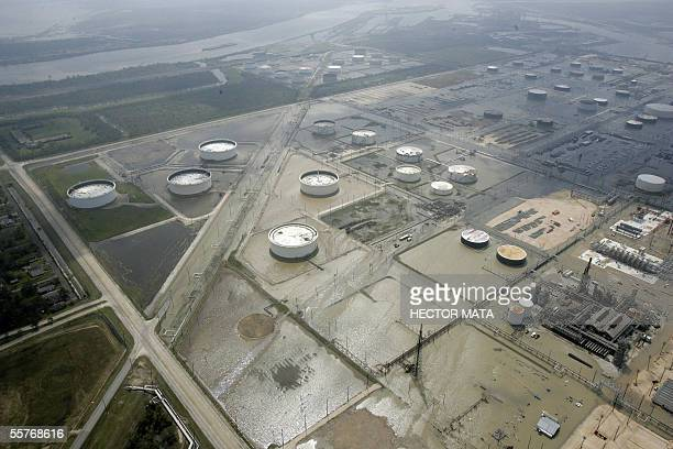 This aerial view shows partially flooded oil refinery after Hurricane Rita outside Port Arthur Texas 25 September 2005 Hurricane Rita pounded the US...