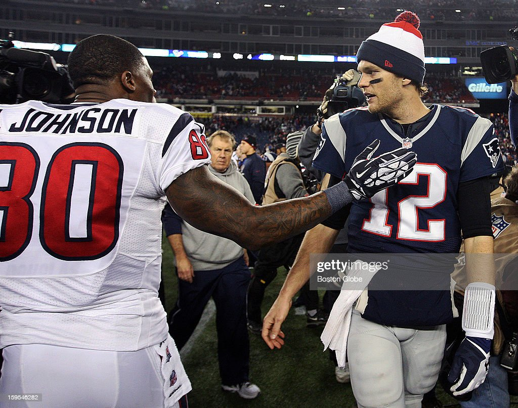 Houston wide reciever Andre Johnson, left, has a pat on the chest and a word with Patriots quarterback Tom Brady, right, after New England's victory. The New England Patriots hosted the Houston Texans in an NFL AFC Divisional Playoff Game at Gillette Stadium, Jan. 13, 2013.