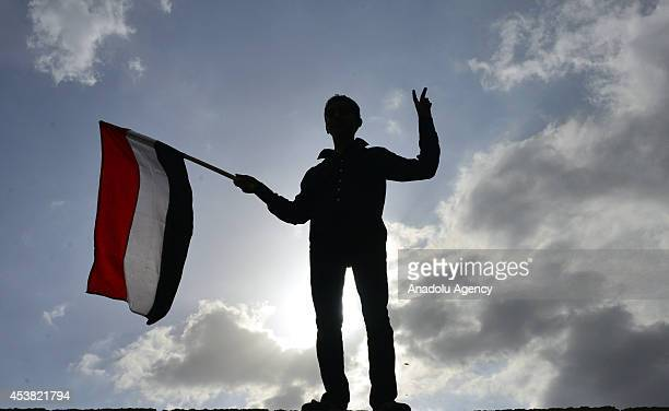 Houthi boy waves a flag during antigovt protest upon a call by Shiite rebel commander AbdulMalik alHouthi in Sanaa capital of Yemen on August 19 2014...