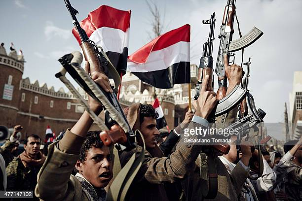 Houthi supporters gather at the old gates to protest against the Saudi Arabian coalition airstrikes on June 14 2015 in Sana'a Yemen UN peace talks...