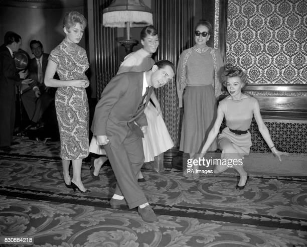 How a curtsey should be done according to Norman Wisdom Watching at the Empire Theatre Leicester Square are female film stars from three nations who...