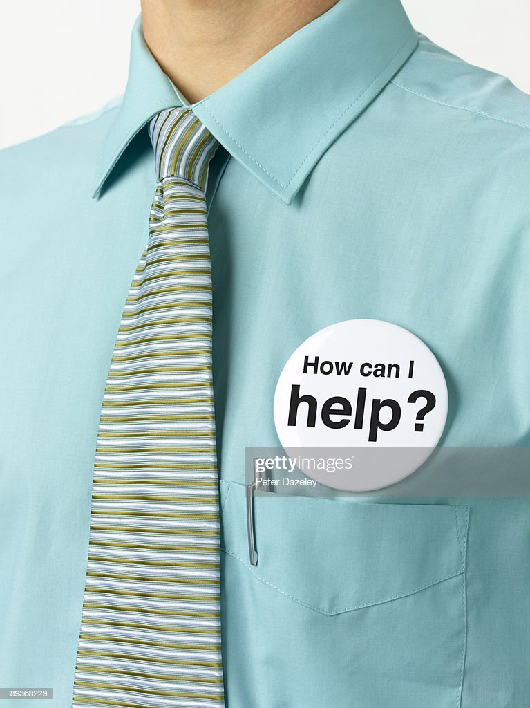 How can I help button badge on blue collar worker. : Stock Photo