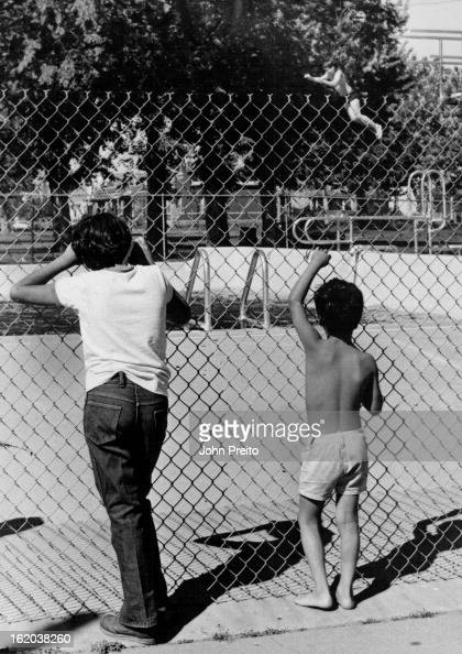 JUN 12 1980 JUN 13 1980 How come that Guy is Having so much fun Larry Saldana and Santiago Carrillo watch enviously as another boy in their age group...