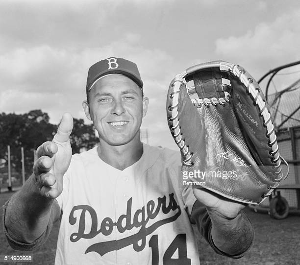How Could They Get Away Vero Beach Florida Brooklyn dodger infielder Gil Hodges who owns a pair of the biggest ball catching hands in the league...