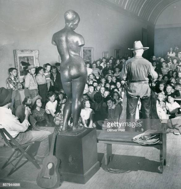 How Did She Get There All eyes are on cowboy Charles J Downing and the museum's nude is virtually forgotten except as a resting place for a guitar as...