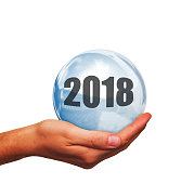 Hand with glass ball and number 2018