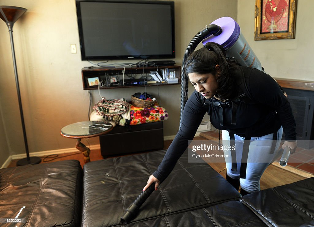 How to hire a housecleaning service for your home. Yareli Gonzalez of Wendy's Cleaning Service works the vacuum as she cleans a home in Denver on Tuesday, April 8, 2014.