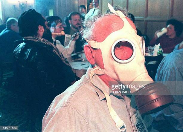 Howard Alan a judge at the 15th Annual Chicago Pipe Smoking Contest dons a gas mask in an effort to cut down his intake of secondhand smoke 12 March...