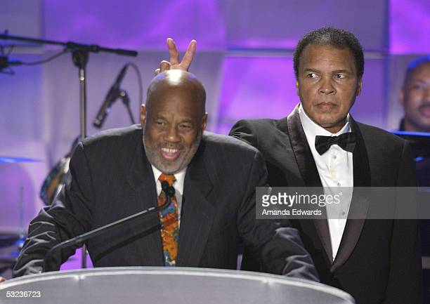 Howard Bingham and boxer Muhammad Ali speak on stage during the 20th Annual 'Midsummer Night's Magic Awards Dinner' on July 13 2005 at the Century...