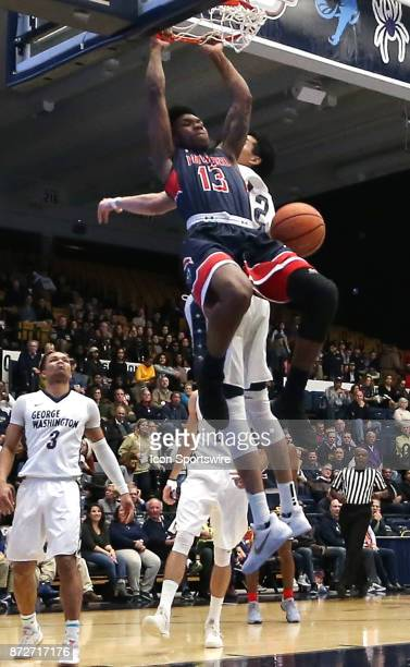 Howard Bison forward Charles Williams beats George Washington Colonials guard Yuta Watanabe to score during a men's college basketball game between...