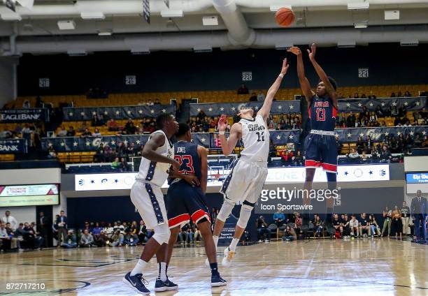 Howard Bison forward Charles Williams lobs a shot over George Washington Colonials guard Yuta Watanabe during a men's college basketball game between...