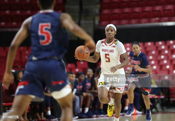 Howard Bison guard Sarah Edmond gets set to defend against Maryland Terrapins guard Kaila Charles during a women's college basketball game between...