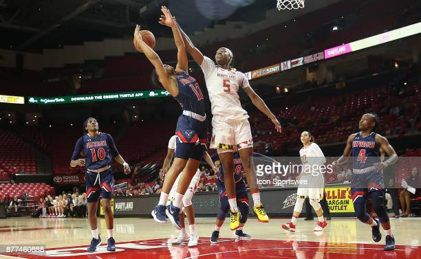 Howard Bison guard/forward Curstyn Moore and Maryland Terrapins guard Kaila Charles challenge for a rebound under the basket during a women's college...