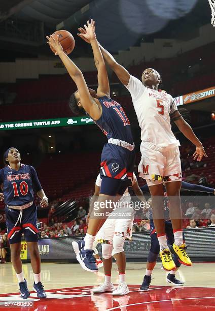 Howard Bison guard/forward Curstyn Moore and Maryland Terrapins guard Kaila Charles leap up for the ball during a women's college basketball game...