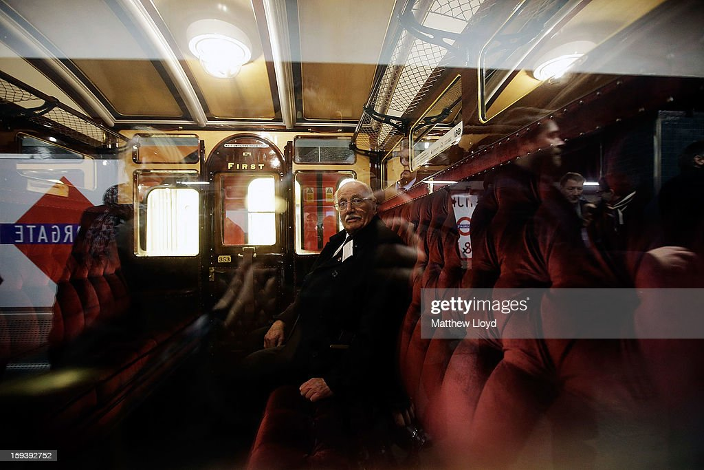 Howard Carey sits in a first class carriage pulled by a restored steam engine built in 1898, known as Met Locomotive No. 1, after it arrives at Moorgate station in a recreation of the first London Underground journey on January 13, 2013 in London, England. The London Underground celebrates its 150th birthday this month, the Metropolitan line being the first stretch between Paddington and Farringdon stations.