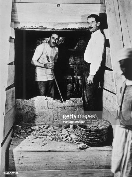 Howard Carter and a colleague excavating a tomb in the Valley of the Kings Egypt 1922 Carter and another archaeologist standing beside a partially...