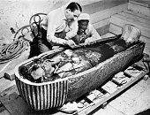 Howard Carter english egyptologist near golden sarcophagus of Tutankhamon in Egypt in 1922
