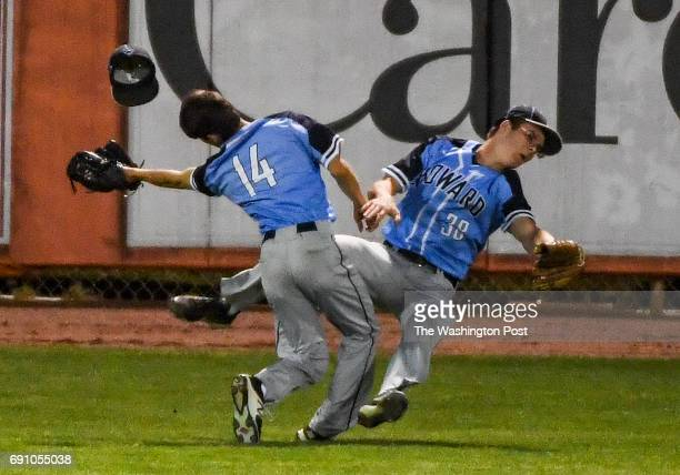 Howard centerfielder Jake Alagna collides with left fielder Brendan Foster as they go for a fly ball by Northwest Nick Phelps in the fifth inning...