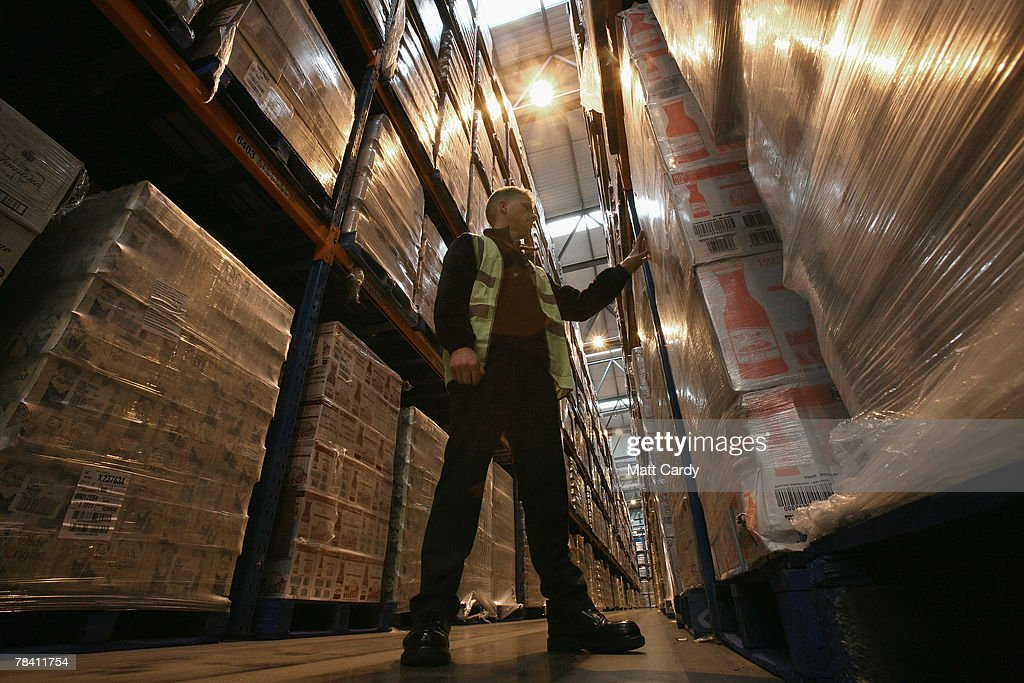 Howard Cobb checks the stock about to be sent out at the giant distribution centre in Avonmouth on December 12 2007 near Bristol, England. The giant warehouse, owned by Constellation Europe, is currently packed full of pallets of alcohol to be dispatched - with 90per cent destined for the UK - which means a lorry leaving every seven minutes, 24 hours a day, to keep up with demand.